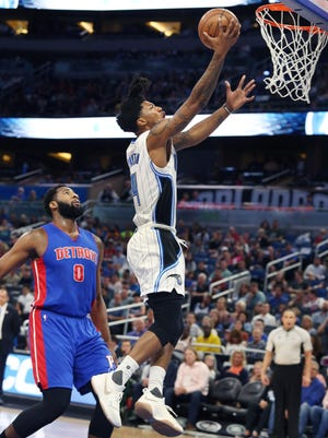 The Magic's Elfrid Payton scores over the Pistons' Andre Drummond at the Amway Center in Orlando on Wednesday, April 12, 2017.
