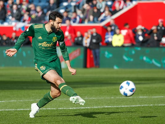 Portland Timbers midfielder Diego Valeri kicks and scores against the Chicago Fire during the first half of an MLS soccer match, Saturday, March 31, 2018, in Bridgeview, Ill. (AP Photo/Kamil Krzaczynski)