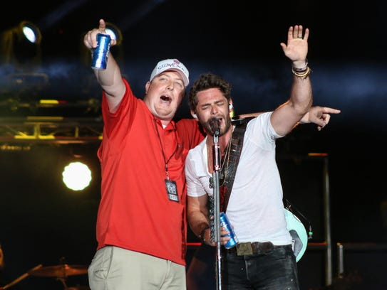 Thomas Rhett invites a fan on stage to sing with him