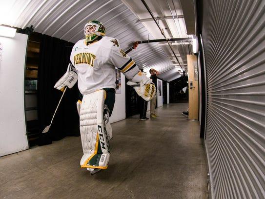 Vermont goalie Stefanos Lekkas (40) heads to the ice