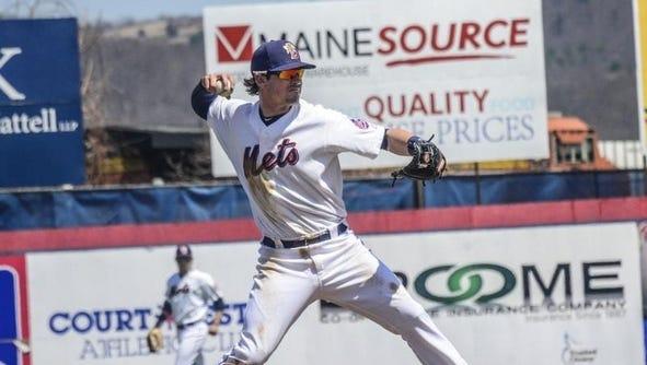 Shortstop Matt Reynolds makes a throw across the diamond at NYSEG Stadium during the 2014 Binghamton Mets season.