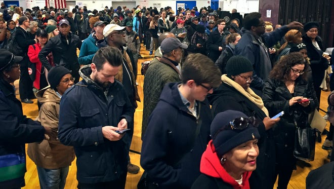 Voters line up in crowds at a polling site to cast their ballots, Tuesday Nov. 8, 2016, in the Flatbush section of Brooklyn in New York.