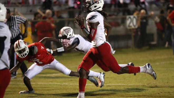 Wakulla's Jaylon Worsham sprints in to the endzone for a touchdown during their game against Leon at Cox Stadium on Thursday night.