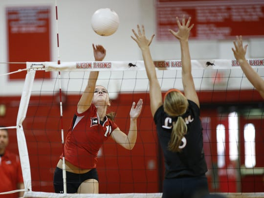 Leon's Caroline Dempsey spikes the ball past her varsity teammates during the fall Red and White game at the school on Tuesday, Aug. 18, 2015.