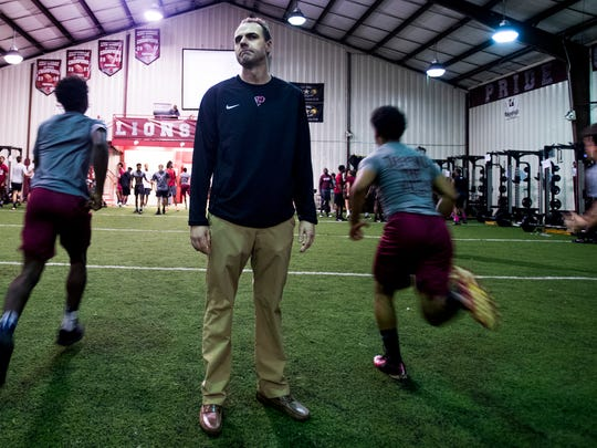 Prattville High School football coach Caleb Ross looks on during his teams weight training at the school in Prattville, Ala. on Wednesday April 4, 2018.
