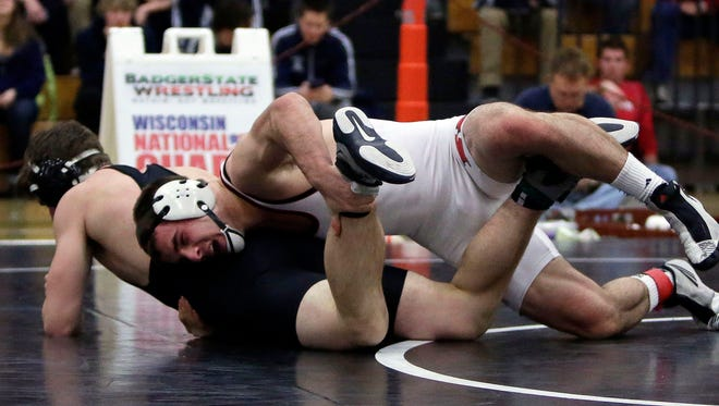 Blair Mulholland of Kimberly wrestles Anthony Schlass of West Bend West in the 182-pound weight class during a WIAA Division 1 sectional at Kaukauna High School on Saturday.