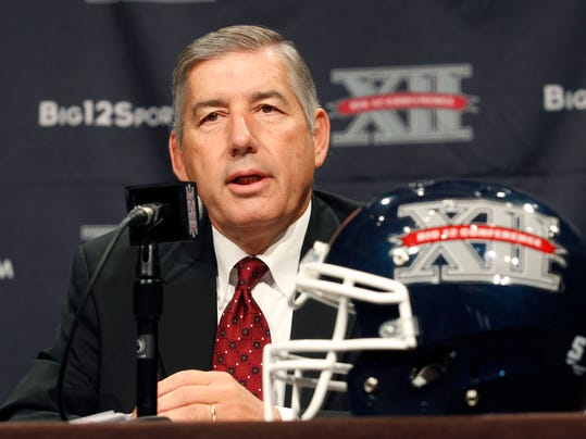 """In this July 22, 2013, file photo, Big 12 Conference Commissioner Bob Bowlsby addresses the media at the beginning of the Big 12 Conference Football Media Days in Dallas. The bowl system has finally snapped after years of being stretched thin. Three teams with losing records will be among the 80 playing in a record 40 bowl games over the next month and two teams from the same conference will play each other in a bowl. """"I think the fact is we do have too many bowl games and we have more bowl games waiting in the wings,"""" Bowlsby said. """"But you can't fault the communities from going and ahead and doing something if they want to. We're going to have to do a deep dive on it and figure it out.""""  (AP Photo/Tim Sharp, File)"""