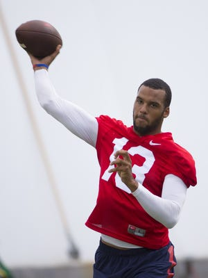 Arizona quarterback Brandon Dawkins, #13,  practices at the Cardinals' training facility in Tempe on August 11, 2016.