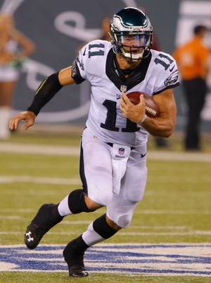 Philadelphia Eagles quarterback Tim Tebow (11) carries the ball during second half against the New York Jets at MetLife Stadium.
