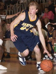 Trevor Cooney, here playing for Sanford School as an 8th-grader, drives to the basket in a 2007 Kappa Klassic game at Glasgow High School.