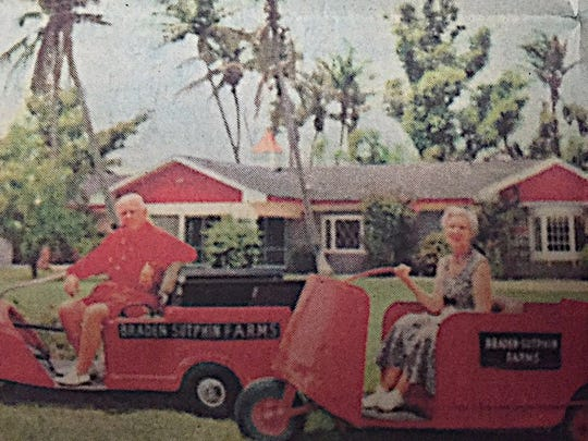 Al and Mary Sutphin in front of the little red-and-white houses he built at their retreat.