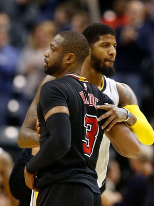 Dec 30, 2016; Indianapolis, IN, USA; Indiana Pacers forward Paul George (13) hugs Chicago Bulls guard Dwayne Wade (3) after their game at Bankers Life Fieldhouse. Indiana defeated Chicago 111-101.