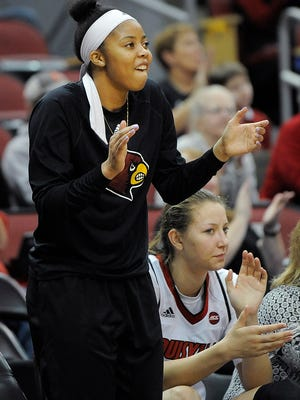 Louisville's Arica Carter encourages her teammates as the Cardinals take on Boston College on Sunday at the KFC YUM! Center. Louisville won 68-43.  Feb.12, 2017