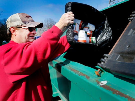 Ron Johnson recycles medal cans at the Rutherford County