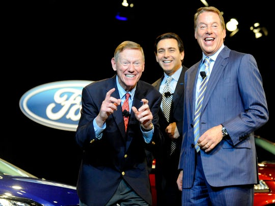 Retiring Ford Motor CEO Alan Mulally makes a picture-taking gesture while clowning around with the company's new CEO Mark Fields, center, and Ford executive chairman Bill Ford Jr. at the Ford World Headquarters in Dearborn on May 1.