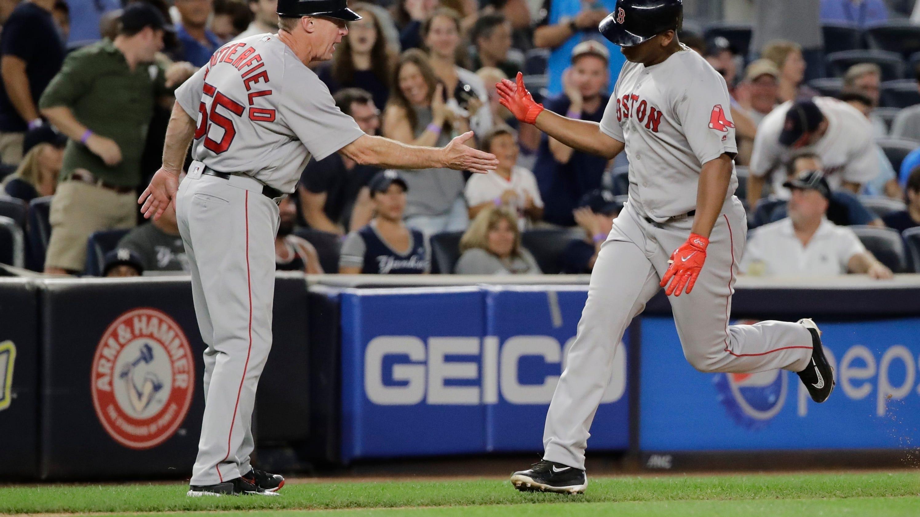 Red Sox rookies Devers, Benintendi key win over Yanks in 10