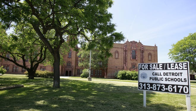A for sale sign sits out front of the old Cooley High School building on Wednesday, May 23, 2012. in Detroit. The three-story Mediterranean Revival-style facility located at 15055 Hubbell Avenue, was closed in 2010 after budget constraints and declining enrollment.