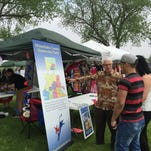 Members of the Minnehaha County Democratic Party talk to people at the Cinco de Mayo Fiesta in Sioux Falls Saturday about registering to vote as Democrats.