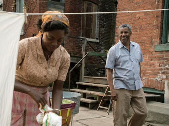 """This image released by Paramount Pictures shows Denzel Washington, right, and Viola Davis in a scene from """"Fences,"""" directed by Washington."""