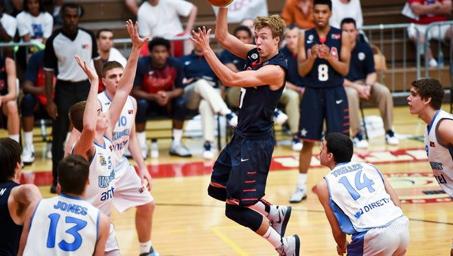 U.S. guard Luke Kennard passes the ball out of the key during pool play against Uruguay at the FIBA Americas under-18 basketball championships in Colorado Springs.