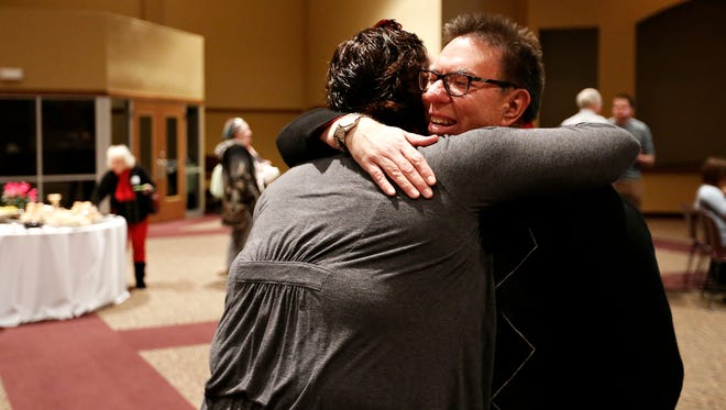 Rev. Jim Harriger and Laura Rush embrace during Harriger's retirement ceremony, held at Central Assembly of God in Springfield on Jan. 23, 2016.