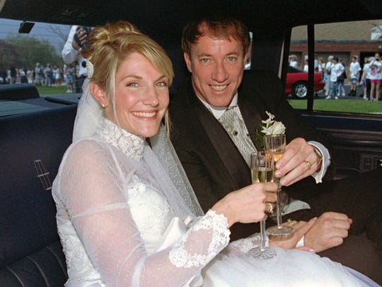 Jim Kelly and his new bride, the former Jill Waggoner, share a toast in the back of a limousine after their wedding May 18, 1996, at St. Christopher's Roman Catholic Church in the Buffalo suburb of Tonawanda.