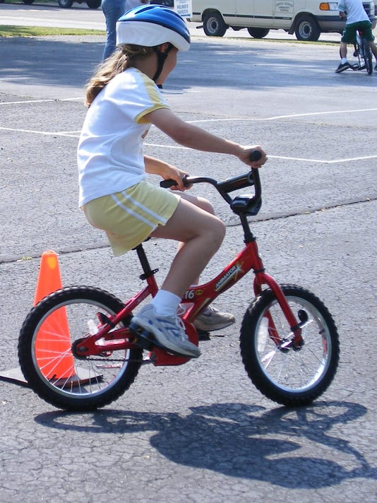 636008084043272085-GIRL-BIKING.jpg