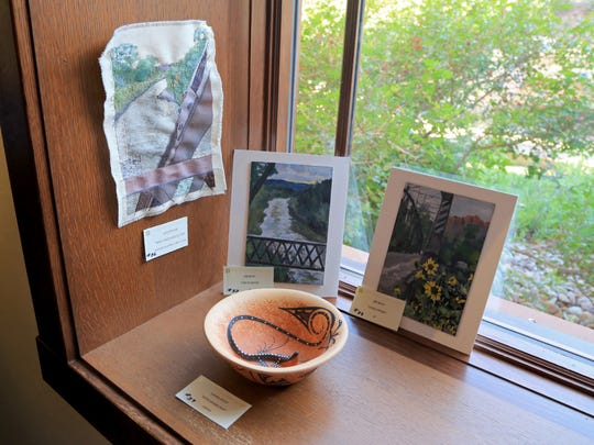 The current exhibit at the Canyon Community Center in Springdale includes 56 works of art by 34 different artists built around the theme of the historic Rockville Bridge.