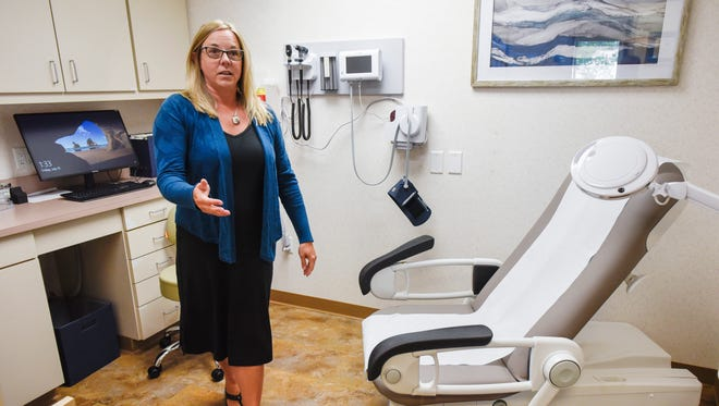 Dr. Julie Anderson shows an exam room Friday, July 13, at her new primary care facility opening called Simplicity Health in St. Cloud.