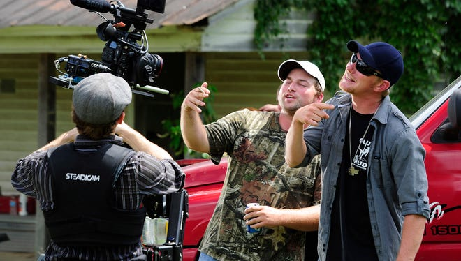 """Lenny Cooper and Charley Farley rap together for a music video for Cooper's song """"Country Folks Anthem"""" on location at Wooley's in Mooreville, Tenn."""