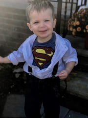 Cole McKeon dressed as Superman last Halloween. The two-year-old Ridgewood resident is battling cancer.