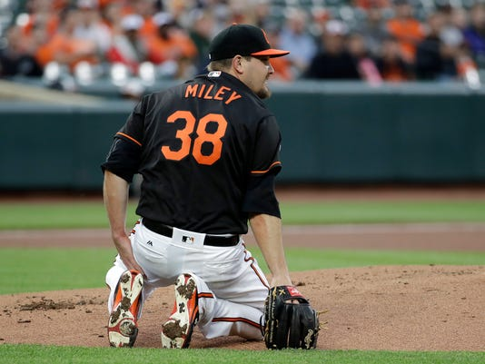 Baltimore Orioles starting pitcher Wade Miley gets up after being hit by a line drive single by Chicago White Sox's Avisail Garcia in the first inning of a baseball game in Baltimore, Friday, May 5, 2017. (AP Photo/Patrick Semansky)