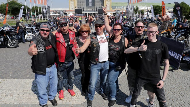 Gary Radmer of Slinger (from left); Wong Si Wei of Shanghai, China; Wendy Radmer of Slinger; Theo and Peggy Kindts of Amsterdam; Robert Van Ollefen, of Amsterdam; and his son Duncan Van Ollefen gather at the Harley-Davidson 115th anniversary celebration in Prague. The group met at the Harley-Davidson Praha dealership, on the outskirts of Prague.