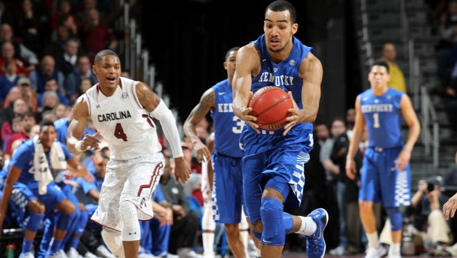 Kentucky forward Trey Lyles rushes down court after stealing a pass as South Carolina defender Tyrone Johnson (4) tries to catch up to the action in the first half of an NCAA college basketball game, Saturday, Jan. 24, 2015, at the Colonial Life Arena in Columbia, S.C. (AP Photo/Willis Glassgow)