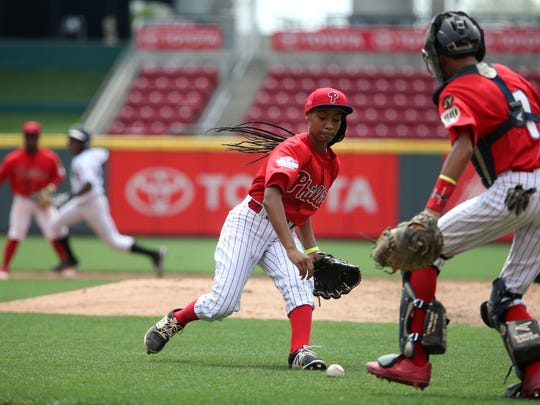 Phillies RBI pitcher Mo'ne Davis fields a ground ball in the fifth inning during regional play in the 2017 RBI World Series, Aug. 1, 2017, at Great American Ball Park in Cincinnati.
