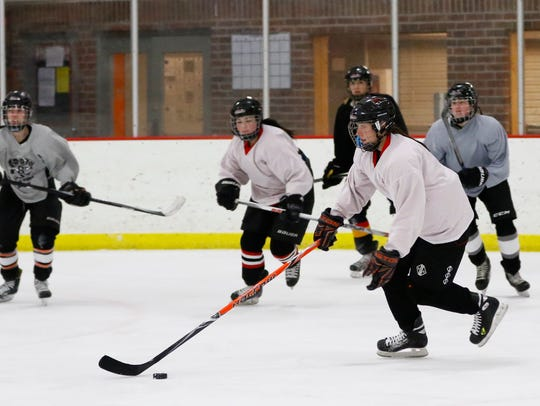 The Red Panthers girls hockey team works on drills