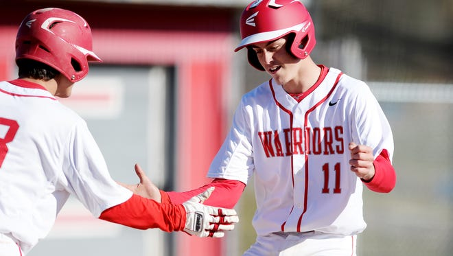 Tyler Anders (11) hit a grand slam for Erwin in Thursday's 12-6 conference win over Asheville High.
