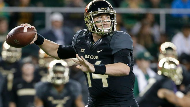 Baylor quarterback Bryce Petty passes in the first half of an NCAA college football game against Kansas State, Saturday, Dec. 6, 2014, in Waco, Texas.