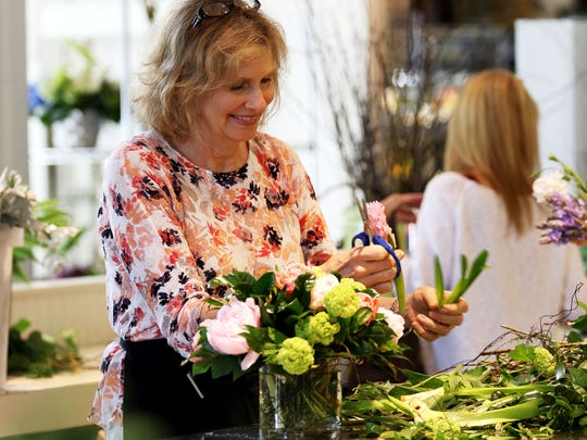 Robin Wood owner of Robin Wood Flowers on Dana Road in Evanston makes a Mother's Day arrangement on Thursday. Wood said she expects about 400 orders for Mother's Day.