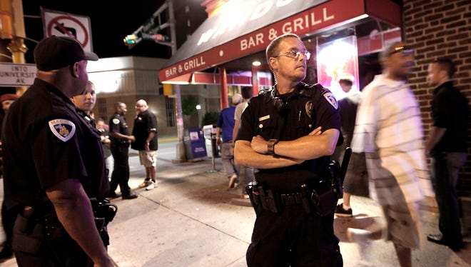 Madison police officer Matthew Kenny, right, patrols a nightclub area on the University of Wisconsin campus in April 2012. District Attorney Ismael Ozanne is weighing whether to file charges against Kenny in the shooting death of Tony Robinson. Kenny, who is white, shot Robinson, who was biracial, on March 6.