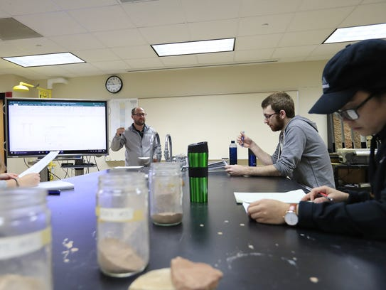 Assistant professor Ryan Holzem lectures during a Environmental