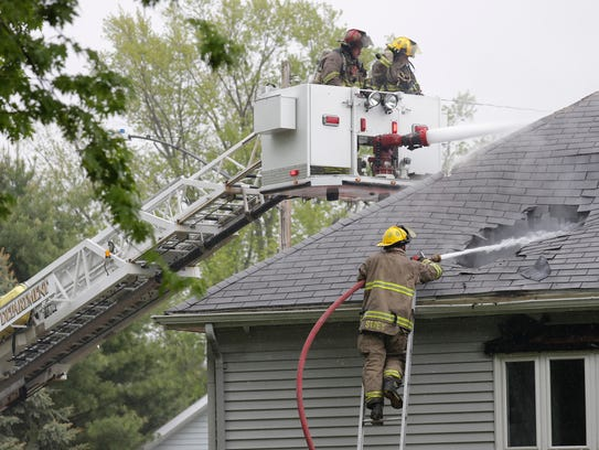 Firefighters try to extinguish a fire located at 524