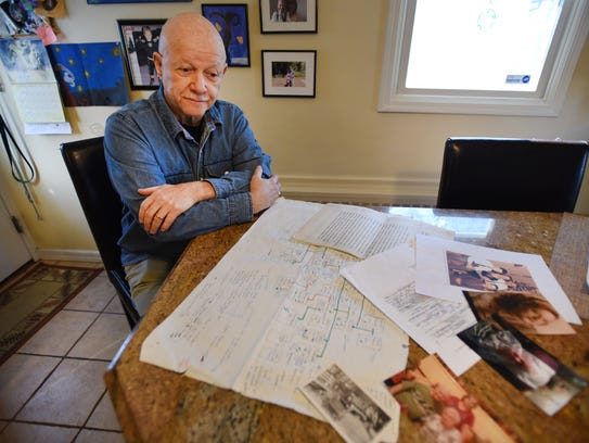 Bob MacNish, 73, in his New Milford home with documents
