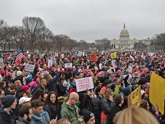 Demonstrators protest on the National Mall in Washington, DC, for the Women's March on January 21, 2017. Hundreds of thousands of protesters spearheaded by women's rights groups demonstrated across the US to send a defiant message to US President Donald Trump. / AFP PHOTO / Andrew CABALLERO-REYNOLDSANDREW CABALLERO-REYNOLDS/AFP/Getty Images