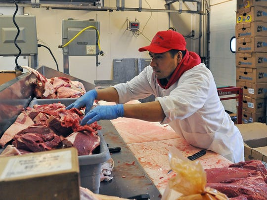 Toribio Bautista, one of 15 employees at Marcacci Meats,