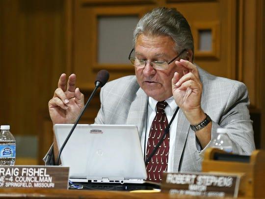 Springfield City Councilman Craig Fishel uses air quotes