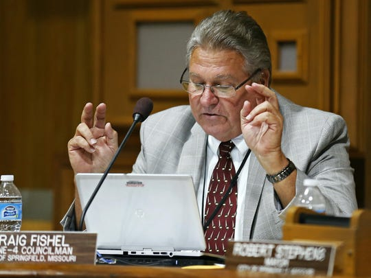 Springfield City Councilman Craig Fishel uses air quotes