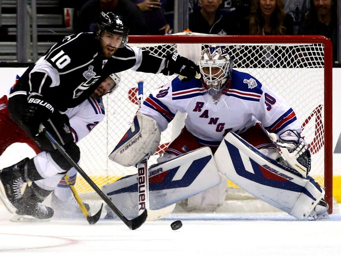 Henrik Lundqvist #30 of the New York Rangers tends goal against Mike Richards #10 of the Los Angeles Kings in the first period during Game One of the 2014 NHL Stanley Cup Final at the Staples Center on June 4, 2014 in Los Angeles, California.
