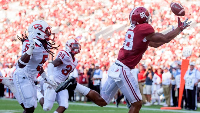 A pass goes off of the fingertips of  Alabama tight end O.J. Howard (88) in the end zone against Western Kentucky in second half action at Bryant Denny Stadium in Tuscaloosa, Ala., on Saturday September 10, 2016.