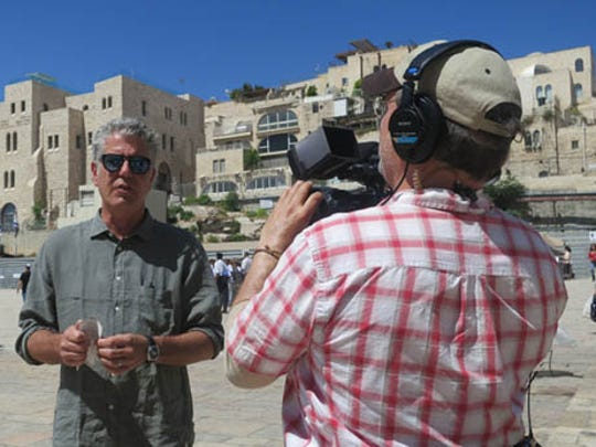"Anthony Bourdain with a member of his film crew in Jerusalem for ""Parts Unknown"" in 2013."
